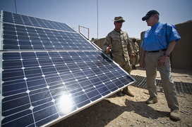 800px-us_navy_110625-n-uh963-102_secretary_of_the_navy__secnav__the_honorable_ray_mabus_observes_an_aray_of_solar_panels_while_receiving_a_tour_of_the_bo