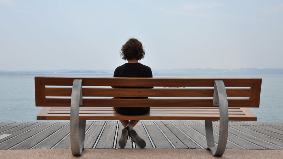 Woman_sitting_alone_on_bench