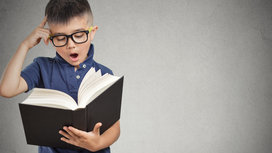 Little_boy_reading_book
