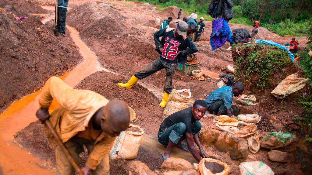 """Miners at a cobalt mine in the Congo. This is an """"artisanal"""" mine where the mining is done by hand."""