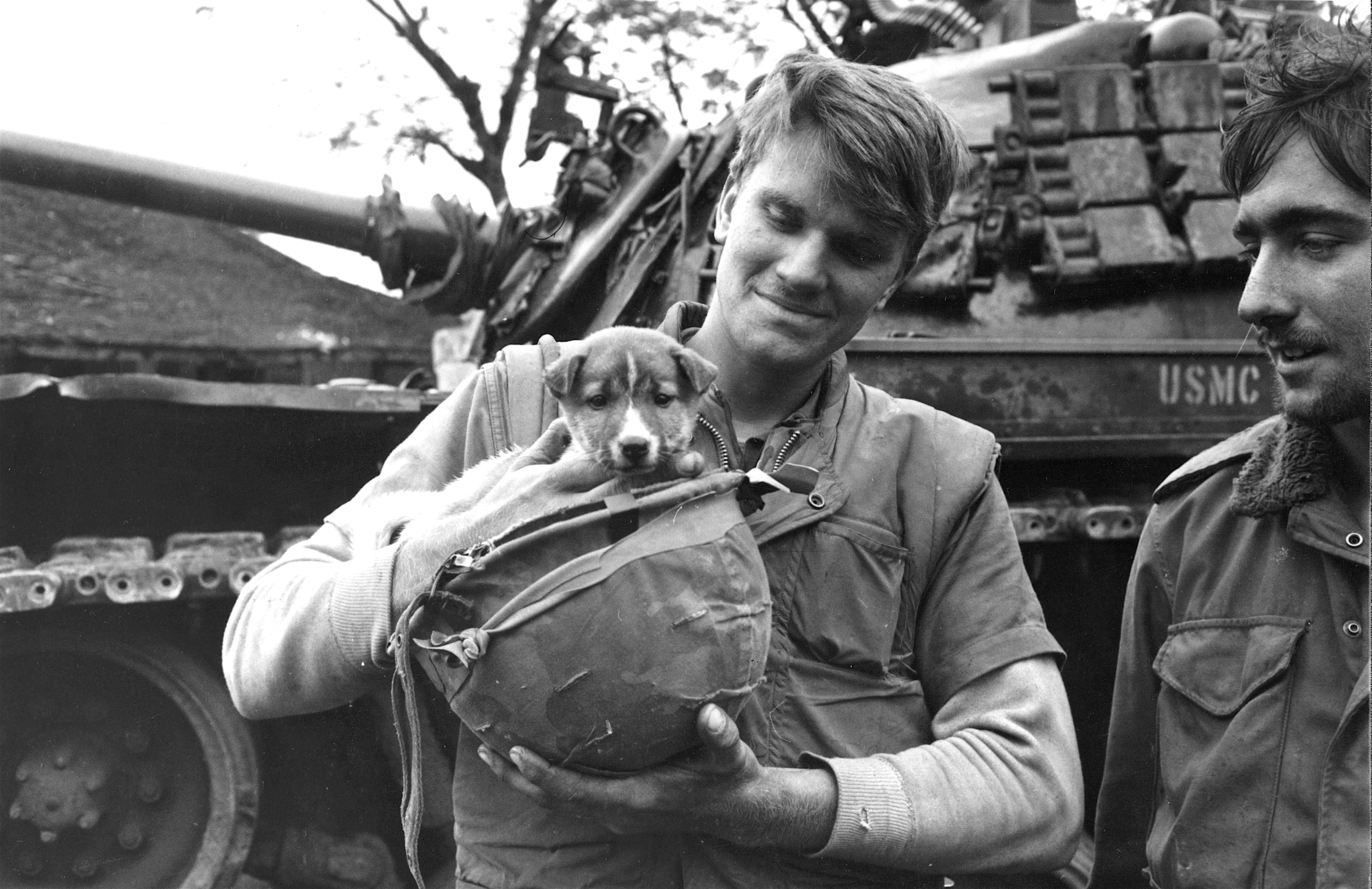 American marines with their pet dog in Vietnam.
