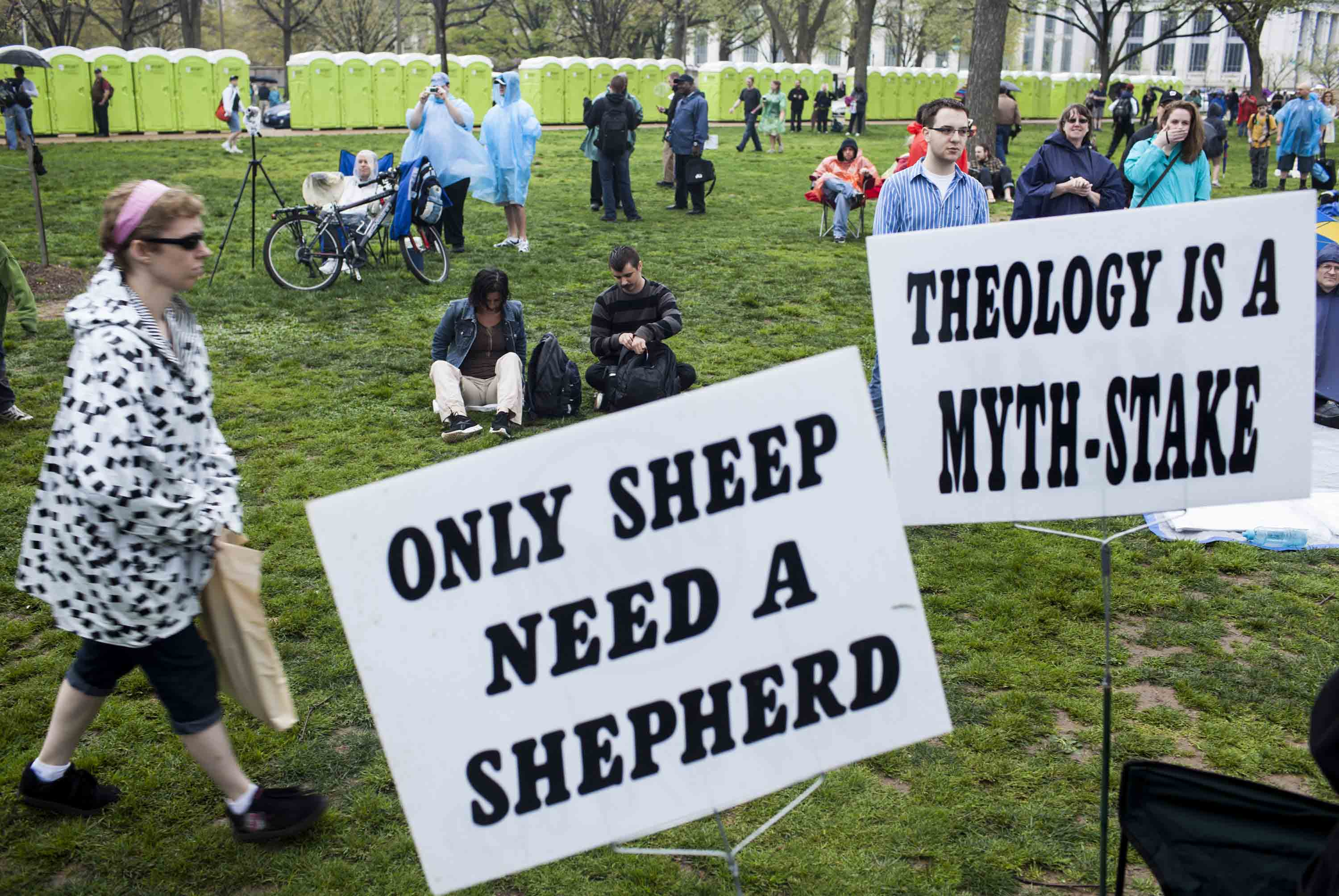 """A rally for reason with a sign reading """"ONLY SHEEP NEED A SHEPHERD"""""""